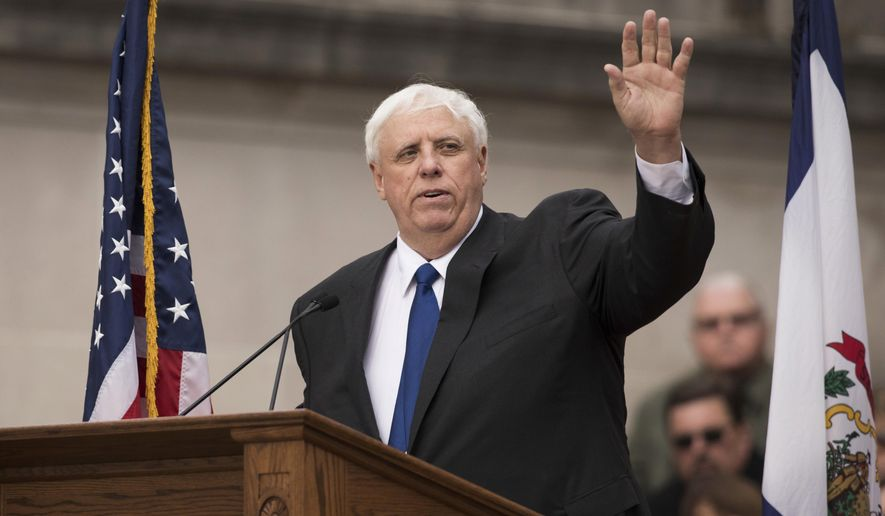 West Virginia Gov. Jim Justice waves to the crowd as he delivers his inauguration speech, Monday, Jan. 16, 2017, in Charleston, W.Va. (AP Photo/ Walter Scriptunas II)