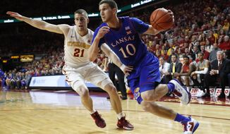 Kansas guard Sviatoslav Mykhailiuk (10) drives past Iowa State guard Matt Thomas during the first half of an NCAA college basketball game, Monday, Jan. 16, 2017, in Ames, Iowa. (AP Photo/Charlie Neibergall)