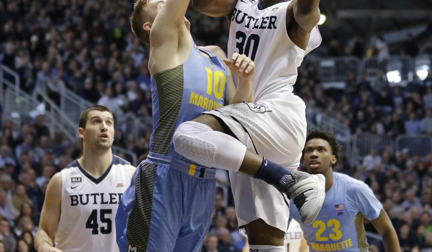 Butler forward Kelan Martin (30) shoots over Marquette guard Sam Hauser (10) in the first half of an NCAA college basketball game in Indianapolis, Monday, Jan. 16, 2017. (AP Photo/Michael Conroy)