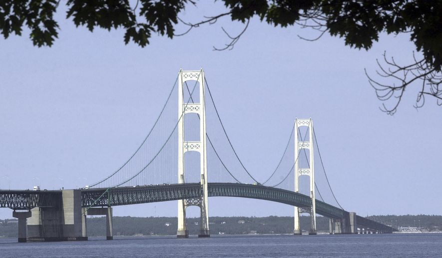 "FILE - In this July 19, 2002 file photo, the Mackinac Bridge is shown from Mackinaw City, Mich. The state of Michigan wants to help residents and visitors pronounce the names of 2,200 places, people and things in or connected to the Great Lakes state, from Aaliyah (uh-LEE'-uh) to Zilwaukee (zil-WAW'-kee). The Michigan Braille and Talking Book Library recently announced the creation of a guide called ""You Say it How in Michigan?"" with audio and phonetic pronunciations. The directory was developed for audio book production for the blind and visually impaired, but its writers say the guide can benefit anyone curious about the state of MISH'-uh-gun.(AP Photo/Carlos Osorio, File)"
