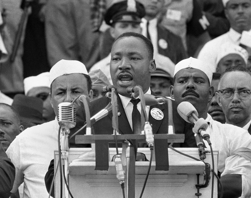 """In this Aug. 28, 1963, file photo, Dr. Martin Luther King Jr., head of the Southern Christian Leadership Conference, addresses marchers during his """"I Have a Dream"""" speech at the Lincoln Memorial in Washington. (AP Photo, File)"""