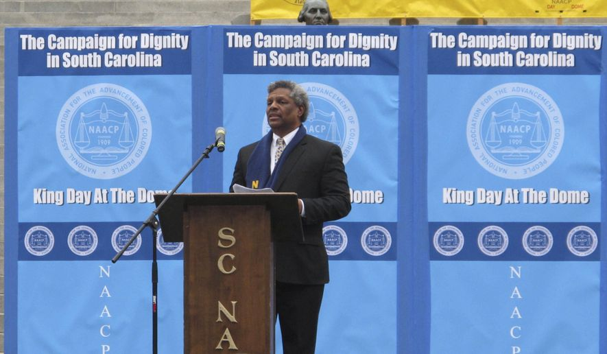 South Carolina NAACP Executive Director Dwight James welcomes marchers to the organization's MLK King Day at the Dome rally at the South Carolina Statehouse on Monday, Jan. 16, 2017, in Columbia, South Carolina. Monday's King Day at the Dome rally was the second since the Confederate flag was removed from Statehouse grounds and one of the most sparsely attended since the event began in 2000. (AP Photo/Jeffrey Collins)