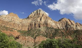 FILE - This Sept. 16, 2015, file photo, shows Zion National Park, near Springdale, Utah. Visits to U.S. national parks set a record in 2016 for the third consecutive year as landmarks such Zion, Yellowstone and Rocky Mountain experienced historic levels of popularity that brought collateral headaches stemming from overcrowded roads and trails and increasing visitor misbehavior. (AP Photo/Rick Bowmer, File)