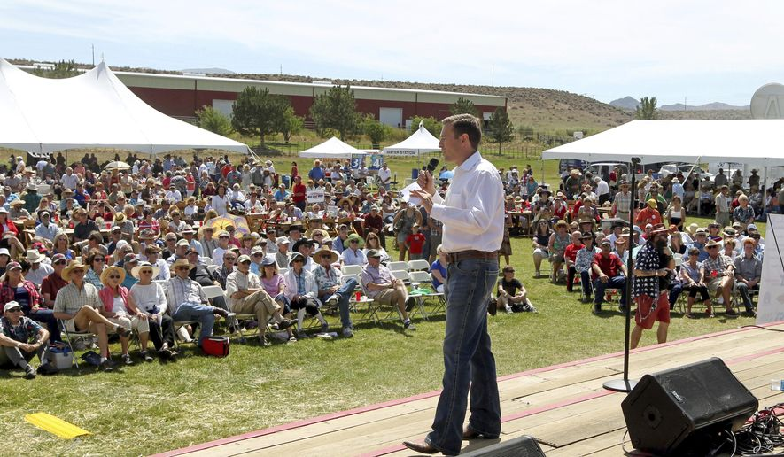FILE - In this Aug. 15, 2015, file photo, Nevada Attorney General Adam Laxalt gives the welcoming remarks at the Inaugural Basque Fry at the Inaugural Basque Fry at Corley Ranch in Gardnerville, Nev. Laxalt, one of the leading Nevada Republicans considering running for governor next year, is showing off a sizable campaign war chest nearly two years before the 2018 election. (AP Photo/Lance Iversen, File)