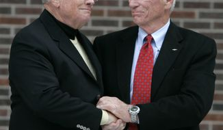 FILE - In a Oct. 27, 2007 file photo, former astronaut Neil Armstrong, left, is congratulated by fellow ex-astronaut Gene Cernan following the dedication ceremony of the Neil Armstrong Hall of Engineering at Purdue University in West Lafayette, Ind. NASA announced that former astronaut Gene Cernan, the last man to walk on the moon, died Monday, Jan. 16, 2017, surrounded by his family. He  was 82. (AP Photo/Michael Conroy, File)