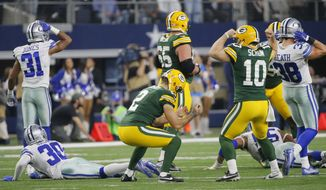 Green Bay Packers kicker Mason Crosby (2) reacts after making the game-winning field goal as time expired against the Dallas Cowboys in an NFL divisional playoff football game Sunday, Jan. 15, 2017, in Arlington, Texas. The Packers won 34-31. (AP Photo/Tony Gutierrez)