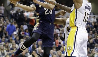New Orleans Pelicans' Anthony Davis makes a pass against Indiana Pacers' Paul George during the first half of an NBA basketball game, Monday, Jan. 16, 2017, in Indianapolis. (AP Photo/Darron Cummings)