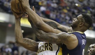 Indiana Pacers' Kevin Seraphin (1) and New Orleans Pelicans' Terrence Jones battle for a rebound during the first half of an NBA basketball game, Monday, Jan. 16, 2017, in Indianapolis. (AP Photo/Darron Cummings)