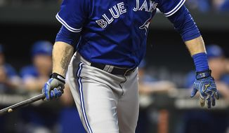 FILE - In this June 17, 2016, file photo, Toronto Blue Jays' Michael Saunders watches his second three-run home run leave the ball park in the fourth inning of a baseball game against the Baltimore Orioles, in Baltimore. Outfielder Michael Saunders and the Philadelphia Phillies have agreed on a one-year, $9 million contract, a person familiar with the negotiations told The Associated Press. Saunders, a 2016 American League All-Star with the Blue Jays, hit a career-best 24 homers and batted .253 with 57 RBIs last season. The person spoke to the AP on condition of anonymity on Monday, Jan. 16, 2017, because the Phillies didn't announce the agreement. (AP Photo/Gail Burton, File)