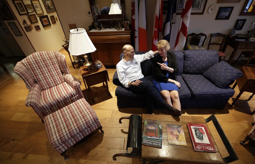 ADVANCE FOR USE TUESDAY, JAN. 17, 2017 AND THEREAFTER-Herschel Talley talks with his wife Betty in their home in Crete, Neb., on Wednesday, Jan. 4, 2017. The couple, who have a son in the National Guard whose unit is perennially under-equipped, say they hope Donald Trump will strengthen the military. They also hope Trump can improve the economy and fix a health care system that they say is so broken that Betty, 62, is still working part-time just to maintain health insurance. (AP Photo/Charlie Neibergall)
