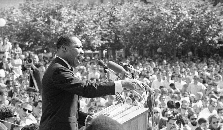 In this May 17, 1967, file photo, Dr. Martin Luther King speaks at the University of California administration building in Berkeley, Calif. (AP Photo, File)