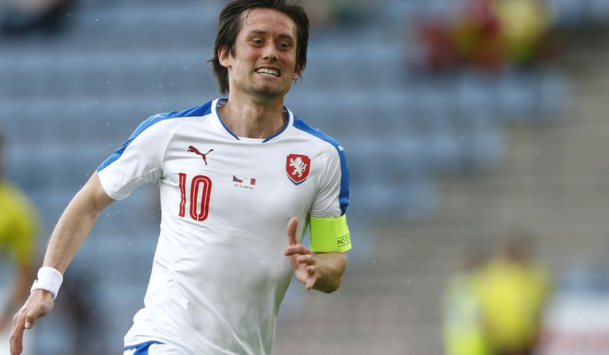FILE - In this Friday, May 27, 2016 file photo, Tomas Rosicky of Czech Republic reacts during a friendly soccer match between Czech Republic and Malta in Kufstein, Germany. Rosicky who is recovering from a long term injury says he is not ruling out a return to the Czech Republic national team, it was reported in Monday, Jan. 16, 2017. (AP Photo/Matthias Schrader, File)
