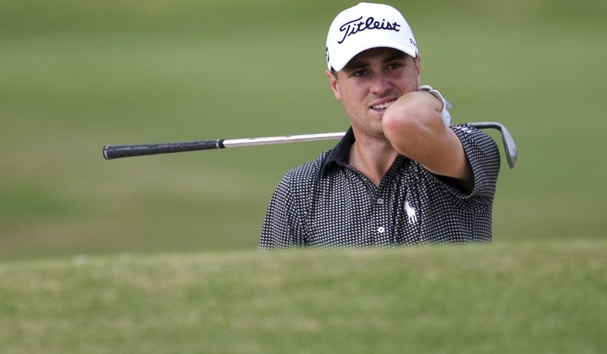 Justin Thomas reacts to his bunker shot on the 13th green during the final round of the Sony Open golf tournament, Sunday, Jan. 15, 2017, in Honolulu. Challenged only by the record book, Thomas won the Sony Open on Sunday with the lowest 72-hole score in PGA Tour history. (AP Photo/Marco Garcia)