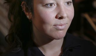 U.S. 6th ranked Amanda Sobhy listens during an interview at the 20th anniversary of the JP Morgan Tournament of Champions professional squash competition, Thursday Jan. 12, 2017, in New York at Grand Central terminal in New York. (AP Photo/Bebeto Matthews)