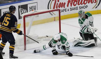 Buffalo Sabres forward Jack Eichel (15) puts the puck past Dallas Stars defenseman Jordie Benn (24) and goalie Kari Lehtonen (32) during the second period of an NHL hockey game, Monday, Jan. 16, 2017, in Buffalo, N.Y. (AP Photo/Jeffrey T. Barnes)