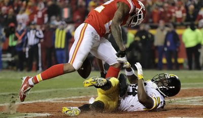 Kansas City Chiefs cornerback Marcus Peters, left, breaks up a pass in the end zone intended for Pittsburgh Steelers wide receiver Antonio Brown, right, during the first half of an NFL divisional playoff football game Sunday, Jan. 15, 2017, in Kansas City, Mo. (AP Photo/Charlie Riedel)