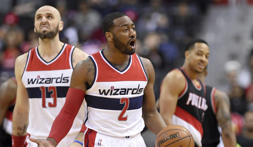 Washington Wizards guard John Wall (2) gestures after he was called for traveling during the first half of an NBA basketball game against the Portland Trail Blazers, Monday, Jan. 16, 2017, in Washington. (AP Photo/Nick Wass)
