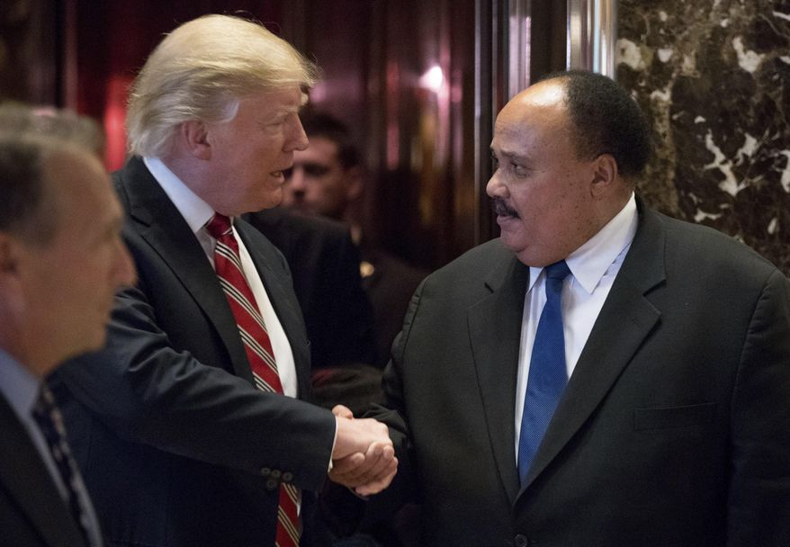 President-elect Donald Trump shakes hands with Martin Luther King III, son of Martin Luther King Jr. at Trump Tower in New York, Monday, Jan. 16, 2017. (AP Photo/Andrew Harnik)