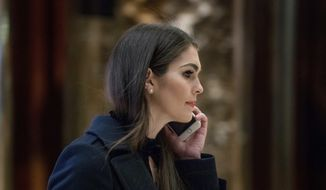 Hope Hicks, press secretary for then-President-elect Donald Trump's campaign, arrives at Trump Tower in New York, Monday, Jan. 16, 2017. (AP Photo/Andrew Harnik) ** FILE **