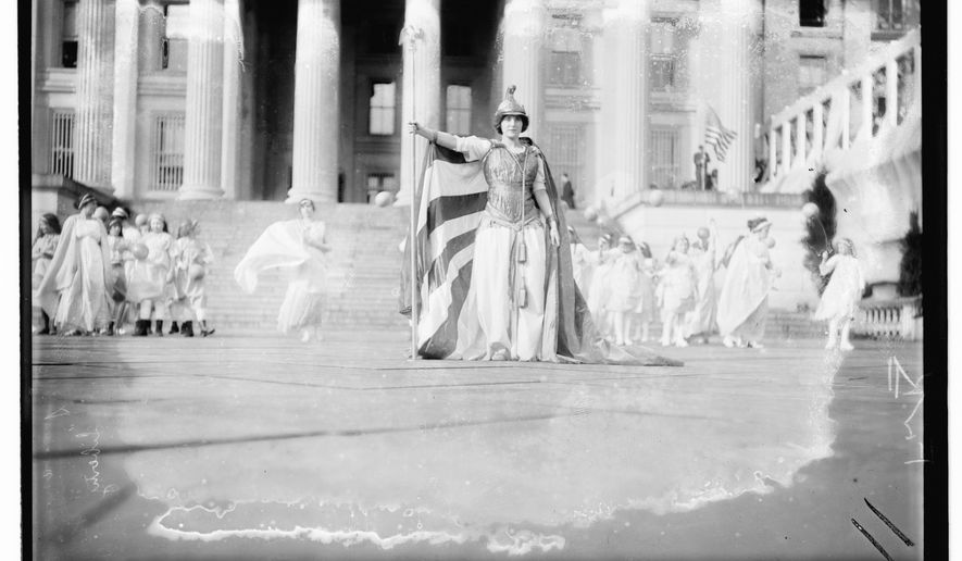 "In this photo provided by the Library of Congress, taken in 1913, German actress Hedwig Reicher wearing costume of ""Columbia"" with other suffrage pageant participants standing in background in front of the Treasury Building in Washington. Thousands of women take to the streets of Washington, demanding a greater voice for women in American political life as a new president takes power. This will happen on Saturday, Jan. 21, 2017, one day after the inauguration of Donald Trump. This DID happen more than 100 years ago, one day before the inauguration of Woodrow Wilson. (Library of Congress via AP)"