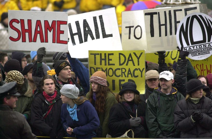 Presidential inaugurations routinely draw protesters, such as this one in 2001, but this year could bring record-shattering crowds against Donald Trump. (Associated Press)