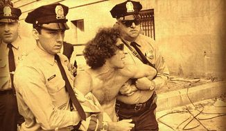 Abbie Hoffman is arrested by police in Washington, D.C. on Oct. 3, 1968. (Associated Press)