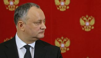 """Moldovan President Igor Dodon attends a joint news conference with Russian President Vladimir Putin in the Kremlin in Moscow, Russia, Tuesday, Jan. 17, 2017. Moldova's new president, who is visiting Russia on his first trip abroad, is voicing hope for rebuilding """"strategic"""" ties with Moscow. (Sergei Ilnitsky/Pool Photo via AP)"""