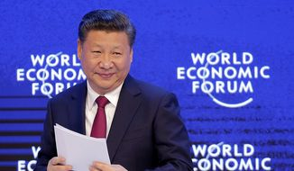 """Chinese President Xi Jinping said at the World Economic Forum in Davos, Switzerland, on Tuesday, """"Pursuing protectionism is like locking oneself in a dark room. Wind and rain may be kept outside, but so are light and air."""" (Associated Press)"""