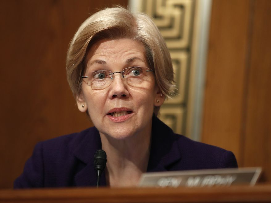 Sen. Elizabeth Warren, D-Mass., questions Education Secretary-designate Betsy DeVos on Capitol Hill in Washington, Tuesday, Jan. 17, 2017, at DeVos' confirmation hearing before the Senate Health, Education, Labor and Pensions Committee. (AP Photo/Carolyn Kaster) ** FILE **