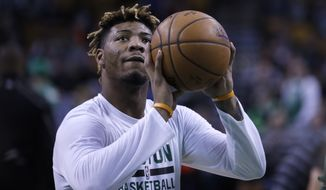 Boston Celtics guard Marcus Smart (36) shoots during warm ups prior to a NBA basketball game in Boston, Wednesday, Jan. 11, 2017. (AP Photo/Charles Krupa)