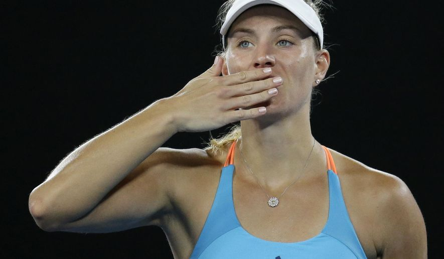 Germany's Angelique Kerber blows a kiss to the crowd after defeating Ukraine's Lesia Tsurenko during their first round match at the Australian Open tennis championships in Melbourne, Australia, Monday, Jan. 16, 2017. (AP Photo/Aaron Favila)