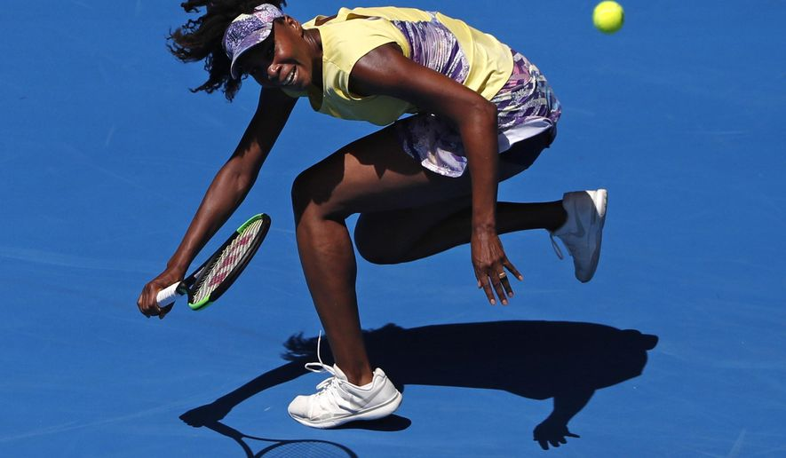 United States' Venus Williams chases down a return shot to Switzerland's Stefanie Voegele during their second round match at the Australian Open tennis championships in Melbourne, Australia, Wednesday, Jan. 18, 2017. (AP Photo/Dita Alangkara)
