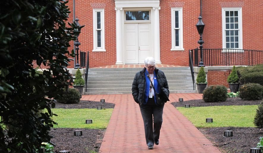 Baltimore Delegate Maggie McIntosh, who chairs the Maryland House Appropriations Committee, leaves the governor's mansion after a budget meeting on Tuesday, Jan. 17, 2017, in Annapolis, Md. McIntosh, a Democrat, says Republican Gov. Larry Hogan's budget plan does not include money for several initiatives lawmakers passed last year to help Baltimore, including funds for a scholarship program and after school programs. Hogan says the state can't afford adding new spending mandates. (AP Photo/Brian Witte)
