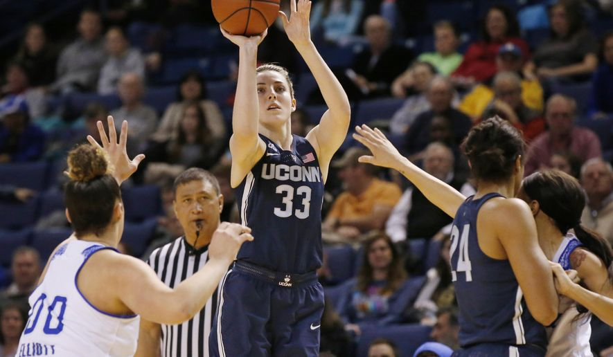 Connecticut's Katie Lou Samuelson (33) shoots in front of Tulsa forward Kendrian Elliott (00), UConn's Napheesa Collier (24) and Tulsa's Ebony Parker, right, during the first quarter of an NCAA basketball game in Tulsa, Okla., Tuesday, Jan. 17, 2017. (AP Photo/Sue Ogrocki)