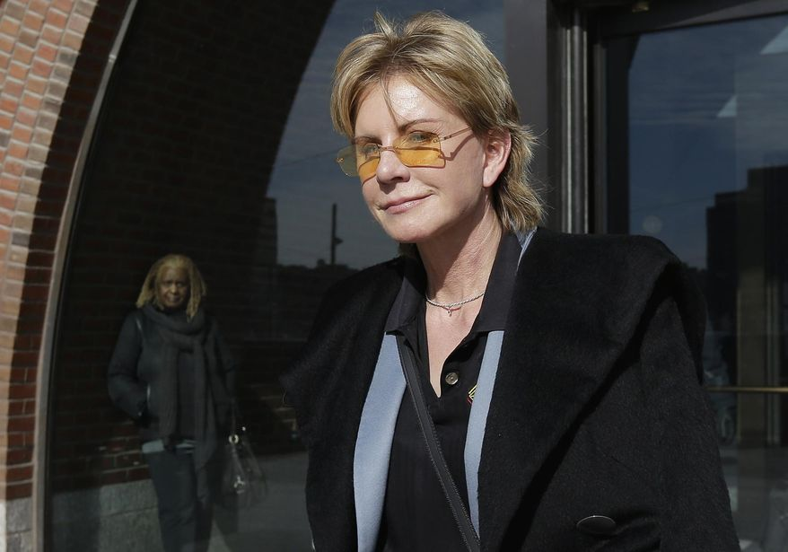 FILE - In a Thursday, Feb. 7, 2013 file photo, author Patricia Cornwell leaves federal court in Boston, after she took the stand in her lawsuit against her former financial management company. Cornwell settled a lawsuit Tuesday, Jan. 17, 2017, against her former business managers, avoiding a second trial for a case that dates to 2009. The author had claimed the New York accounting firm Anchin, Block & Anchin LLP was negligent in handling her finances and cost her millions in losses or unaccounted for revenue. (AP Photo/Steven Senne, File)