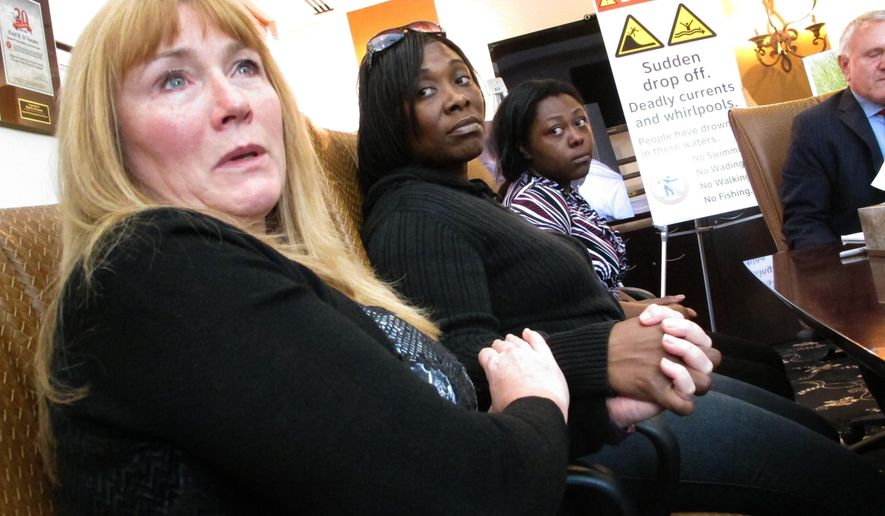 FILE- In this Oct. 25, 2016 photo Sandra Smith, left, Tasha Hart, center, and Domonique McNeil, right, appear at a news conference in Egg Harbor Township N.J., regarding the drowning deaths of relatives at a beach in North Wildwood N.J. Lawyers for Smith's family are trying to get a judge to order that a section of beach be permanently closed to the public because the sand is prone to giving way under the feet of beach goers, plunging them into water over their heads. The town asserts that closing the beach would ruin things for others who still want to go there, and that the unstable sand condition is part of nature and not something the town is obligated to fix. (AP Photo/Wayne Parry, File)