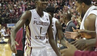 FILE - In this Jan. 10, 2017, file photo, Florida State's Jonathan Isaac, left, celebrates with teammates in the final seconds their victory over Duke in an NCAA college basketball game in Tallahassee, Fla. Isaac got to a strong start before a hip flexor injury forced him to miss three games. The highly heralded freshman struggled in a couple of the games after his return but a double-double against North Carolina has given him a burst of confidence as the 10th-ranked Seminoles face a big week starting with No. 15 Notre Dame on Wednesday. (AP Photo/Steve Cannon, File)