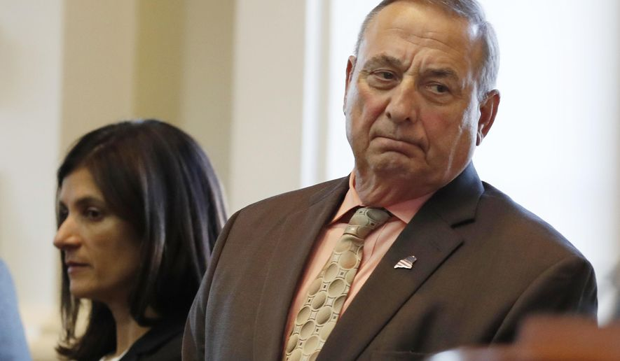 "FILE - In this Monday, Dec. 19, 2016 file photo Maine Republican Gov. Paul LePage, right, and House Speaker Sara Gideon, D-Freeport, attend the Electoral College vote at the State House in Augusta, Maine. The Republican governor on Tuesday, Jan. 17, 2017, addressed Lewis' criticism that GOP President-elect Donald Trump is not a ""legitimate president."" LePage, who's white, said on WVOM-FM that the black Democratic Georgia congressman needs a lesson on how presidents freed the slaves and fought against Jim Crow laws. (AP Photo/Robert F. Bukaty, File)"
