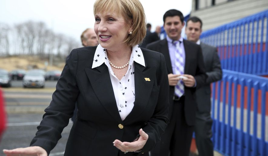 Republican New Jersey Lt. Gov. Kim Guadagno arrives to officially kick off her candidacy for governor, Tuesday, Jan. 17, 2017, in Keansburg, N.J. Guadagno took shots at Republican Gov. Chris Christie as she officially kicked off her candidacy to succeed him. Without mentioning Christie by name, she criticized Christie's proposed $300 million statehouse renovation. She says the state cannot afford to turn the building into the Palace of Versailles. (AP Photo/Mel Evans)