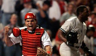 FILE - In this Oct. 4, 1996, file photo, Texas Rangers catcher Ivan Rodriguez reacts after tagging out New York Yankees' Tim Raines, right, as he tried to score in the fourth inning of Game 3 of the American League Divisional playoffs, in Arlington, Texas. Tim Raines and Jeff Bagwell are likely to be voted into baseball's Hall of Fame on Wednesday, Jan. 18, 2017, when Trevor Hoffman and Ivan Rodriguez also could gain the honor. (AP Photo/Eric Gay, File)