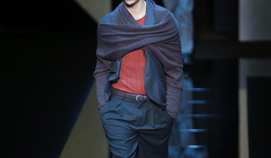 Models wear creations for Giorgio Armani men's Fall-Winter 2017-2018 collection, part of the Milan Fashion Week, unveiled in Milan, Italy, Tuesday, Jan. 17, 2017. (AP Photo/Antonio Calanni)