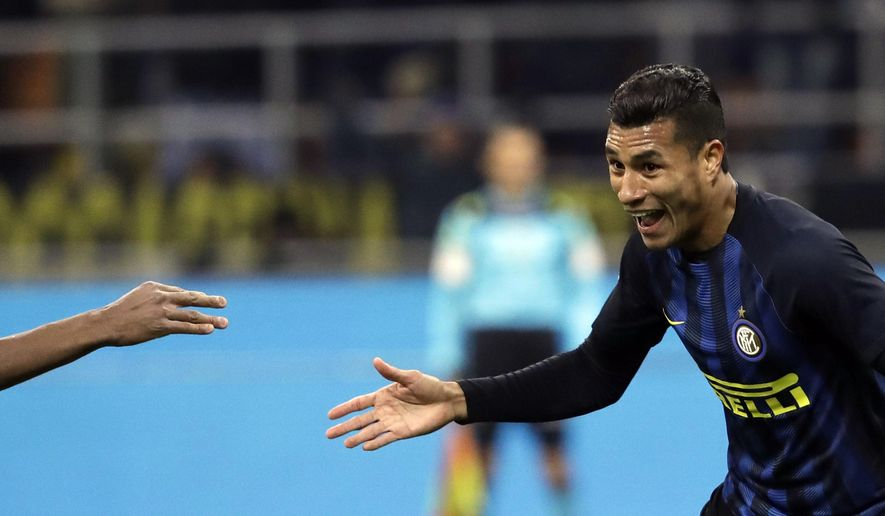 Inter Milan's Jeison Fabian Ceron Murillo, celebrates after scoring during the Italian Cup Soccer match between Inter Milan's and Bologna's in Milan, Italy, Tuesday, Jan. 17, 2017. (AP Photo/Luca Bruno)