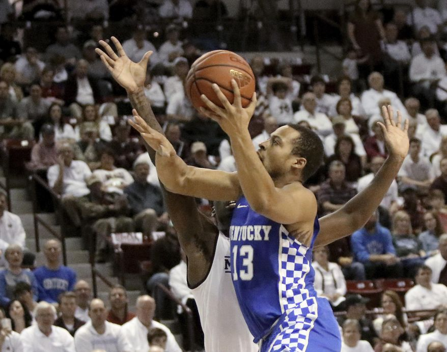 Kentucky guard Isaiah Briscoe (13) shoots a layup around Mississippi State guard Mario Kegler (4) during the first half of an NCAA college basketball game in Starkville, Miss., Tuesday, Jan. 17, 2017. (AP Photo/Jim Lytle)