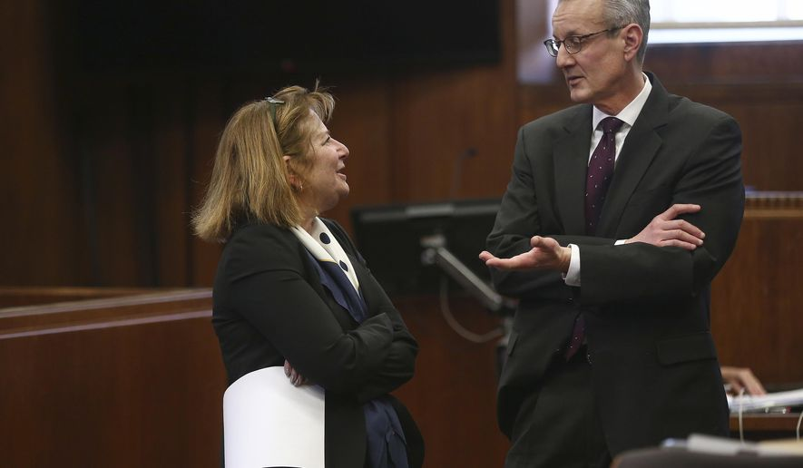 Defense attorney Janice Bassil, left, and Assistant District Attorney David Deakin speak after a hearing on pre-trial motions for Rachelle Bond in Suffolk Superior Court, before Judge Christine Roach, Tuesday, Jan. 17, 2017, in Boston.  Bond is accused of helping dispose of her 2-year-old daughter's body after her boyfriend allegedly killed the girl in 2015. (Pat Greenhouse/The Boston Globe via AP, Pool)