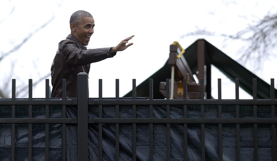 President Barack Obama waves to people in the community during a visit to the Jobs Have Priority Naylor Road Family Shelter in Washington, Monday, Jan. 16, 2017. (AP Photo/Susan Walsh)