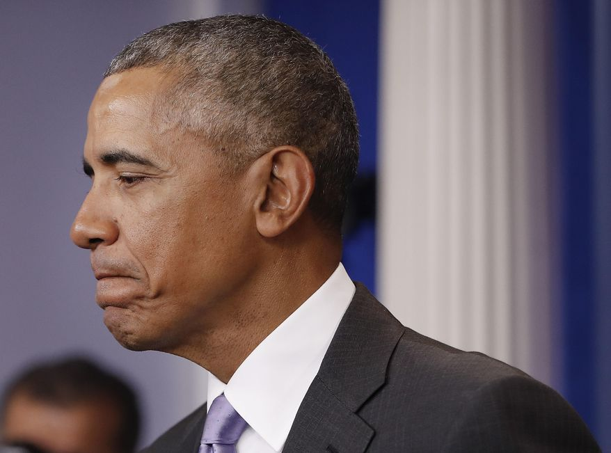 President Barack Obama pauses while speaking at White House press secretary Josh Earnest's final daily press briefing, Tuesday, Jan. 17, 2017, in the briefing room of the White House in Washington. (AP Photo/Pablo Martinez Monsivais)