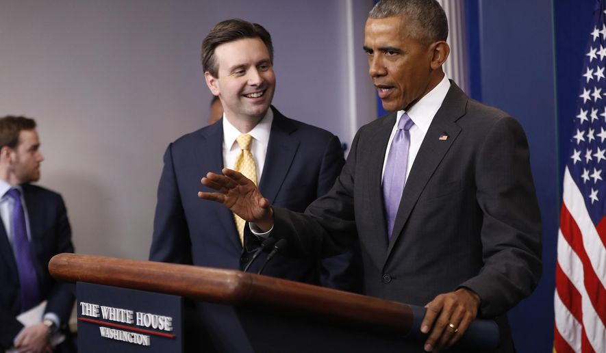 White House press secretary Josh Earnest listens as President Barack Obama speaks at  his final daily press briefing, Tuesday, Jan. 17, 2017, in the briefing room of the White House in Washington. (AP Photo/Pablo Martinez Monsivais)