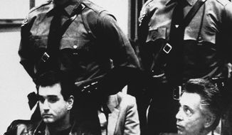 """FILE - In this Nov. 3, 1986 file photo, Nicodemo Scarfo, lower right, and his nephew, Philip Leonetti, lower left, sit in court in Atlantic City, N.J., when the two were brought before a judge to hear new charges of racketeering, loansharking and gambling. Nicodemo """"Little Nicky"""" Scarfo, whose reign over the Philadelphia Mafia in the 1980s was one of the bloodiest in its history, died Saturday, Jan. 14, 2017, at a federal medical center in North Carolina. He was 87. (AP Photo/Pool, File)"""