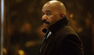 """FILE - In this Jan. 13, 2017, file photo, comedian Steve Harvey arrives in the lobby of Trump Tower in New York to meet with President-elect Donald Trump. Harvey apologized on Jan. 17, 2017 for """"offending anyone"""" with jokes targeting Asian men during his syndicated television chat show earlier this month. (AP Photo/Evan Vucci, File)"""