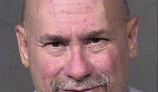 This undated booking photo provided by the Maricopa County Sheriff shows William James Hartwell, who is scheduled to go on trial next week on charges that his pornography-production studio near Phoenix's airport operated as a front for a prostitution ring. Hartwell denies the allegations and accuses the government of criminalizing actions protected by the First Amendment. Prosecutors say Hartwell's actions aren't constitutionally protected. (Maricopa County Sheriff via AP)